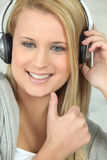 Young woman wearing headphones Stock Image
