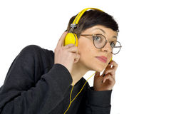 Young Woman wearing headphones listening to music Royalty Free Stock Photo