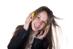 Young Woman wearing headphones listening to music Royalty Free Stock Photography