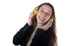 Young Woman wearing headphones listening to music Royalty Free Stock Images