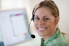 Young Woman Wearing Headset Stock Image