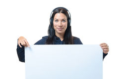 Young woman wearing a headset with a sign stock photos