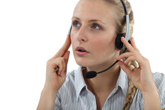 Young woman wearing headset Stock Photos