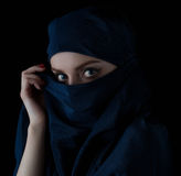 Young woman wearing hijab. Young woman wearing hijab on black background Royalty Free Stock Photos