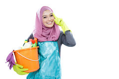 Young woman wearing hijab holding a bucket full of cleaning supp Stock Photos