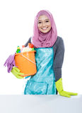 Young woman wearing hijab holding a bucket full of cleaning supp Royalty Free Stock Photography