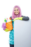 Young woman wearing hijab holding a bucket full of cleaning supp Royalty Free Stock Image