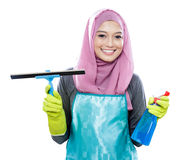 Young woman wearing hijab holding squeegee and cleaning spray Royalty Free Stock Photos