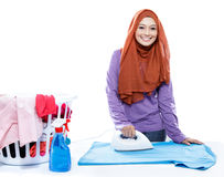 Young woman wearing hijab ironing clothes Royalty Free Stock Image