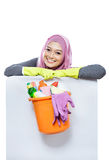 Young woman wearing hijab lying on white board while holding a b Stock Photo