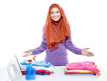 Young woman wearing hijab presenting clean and tidy clothes afte Stock Photo