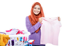 Young woman wearing hijab showing fresh clean clothes Stock Image