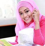 Young woman wearing hijab talking on the phone Stock Photo