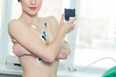 Young woman wearing a Holter Heart Monitor Stock Image