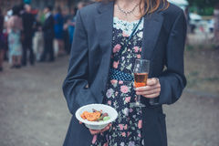 Young woman wearing jacket and drinking wine Royalty Free Stock Image