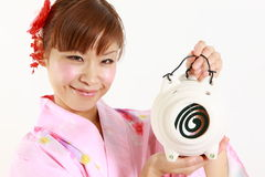Young woman wearing Japanese kimono with mosquito coil. Concept shot of Japanese womans lifestyle Royalty Free Stock Image