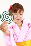 Young woman wearing Japanese kimono with mosquito coil. Concept shot of Japanese womans lifestyle Stock Photo