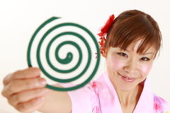 Young woman wearing Japanese kimono with mosquito coil. Concept shot of Japanese womans lifestyle Stock Photography