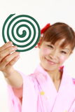 Young woman wearing Japanese kimono with mosquito coil. Concept shot of Japanese womans lifestyle Stock Image