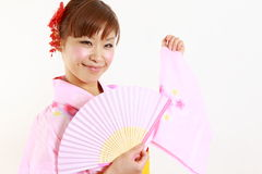 Young woman wearing Japanese kimono with paper Fan. Concept shot of Japanese womans lifestyle Stock Photos