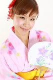 Young woman wearing Japanese kimono with paper Fan. Concept shot of Japanese womans lifestyle Royalty Free Stock Images
