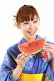 Young woman wearing Japanese kimono with watermelon. Concept shot of Japanese womans lifestyle Royalty Free Stock Photography