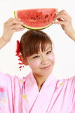 Young woman wearing Japanese kimono with watermelon. Concept shot of Japanese womans lifestyle Royalty Free Stock Photos