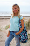 Young woman wearing jeans and t-shirt on beach Royalty Free Stock Image
