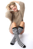 Young Woman Wearing a Jumper and Knee Socks Stock Photo
