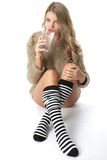 Young Woman Wearing a Jumper and Knee Socks Royalty Free Stock Photography