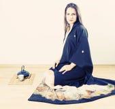 Young woman wearing kimono Stock Images