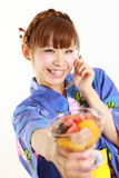 Young woman wearing kimono having Japanese traditional bean jam dessert. Concept shot of Japanese woman's lifestyle Royalty Free Stock Images