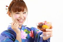 Young woman wearing kimono having Japanese traditional bean jam dessert. Concept shot of Japanese woman's lifestyle Stock Photos