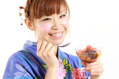 Young woman wearing kimono having Japanese traditional bean jam dessert Royalty Free Stock Photos