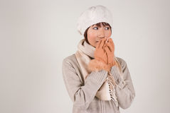 Young woman wearing knit hat. Warming hands Royalty Free Stock Photo