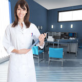 Young woman wearing a  lab coat in an office Royalty Free Stock Photography