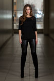 Young Woman Wearing Leather Pants And Long Sleeves Royalty Free Stock Image