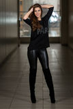 Young Woman Wearing Leather Pants And Long Sleeves Royalty Free Stock Images
