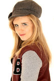 Young woman wearing letterman jacket and a gray hat Stock Photos