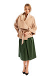 Young woman wearing light colour coat and green skirt Stock Photo