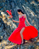 Young woman wearing long red dress Royalty Free Stock Images
