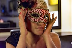 Young woman wearing a mask royalty free stock photos