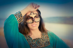 Young Woman Wearing Mask  and Oriental Dress Royalty Free Stock Images
