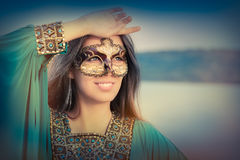 Young Woman Wearing Mask and Oriental Dress royalty free stock photography