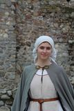 Young woman wearing medieval costume at historical festival Stock Images