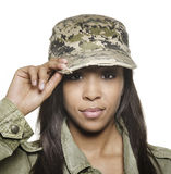 Young woman wearing military cap. Stock Image