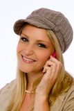Young woman wearing mod cap smiles at camera Stock Images
