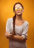 Young woman wearing modern sunglasses Stock Photos