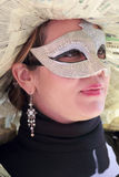 Young woman wearing a newspapers mask Royalty Free Stock Photography