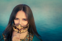 Young Woman Wearing Oriental Dress Holding Mask Royalty Free Stock Photography